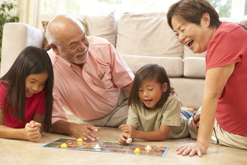 Grandparents playing with the kids
